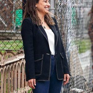 false positive ilana glazer black coat